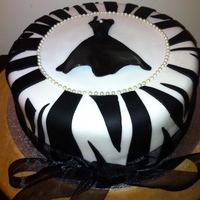 Little Black Dress  Zebra print vanilla flavoured birthday cake with rum buttercream filling. Covered in white sugarpaste. Dress made from sugarpaste. Pearls...