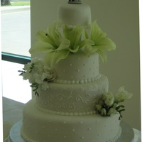 A Spring Wedding Yellow cake with buttercream frosting and ivory fondant - royal icing details and fresh flowers