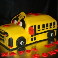 School Bus Cake   Carved, chocolate, fondant covered cake with fondant/gumpaste accents.