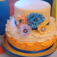 Ombre Ruffle Fondant Wedding Shower Cake Ombre ruffle fondant wedding shower cake with ruffled gumpaste flowers, peach & blue