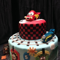 Lightening Mcqueen And Thomas The Train Birthday Cake 10/6 inch fondant cake with gumpaste accents. Lightening McQueen is fondant covered RKT