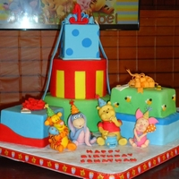 Winnie The Pooh 1St Birthday I made this cake for my babys' first birthday. They were made to simulate different gift boxes. The bows are made out of gumpaste and...
