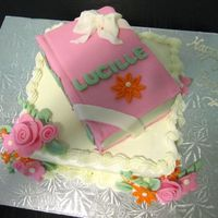 Book Club 80Th Birthday Cake made a fondant book a top of a buttercream cake with fondant flowers