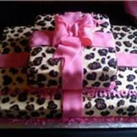 Cheetah Print Giftbox Cake Did this cheetah print out of all buttercream and then topped it with a fondant bow.