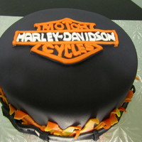 Harley Cake covered in black fondant, flames and a harley logo