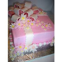 Pink Daisy Present Cake pink present cake with two tone bow and lots of gumpaste daisys