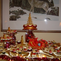 Christmas Party Display  The main cake is rich fruit cake. Irish cream cupcakes, Gingerbread cupcakes, 50/50 gum paste/fondant sleigh & trees.This was a lot of...