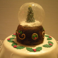 Gelatin Christmas Snow Globe   Globe is made from gelatin. The base is RKT covered in fondant. Tablecloth is also fondant.