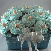 Daisy Baby Shower Cupcake Bouquet   This is similar to another one I made, but this one is for a baby boy. Gumpaste daisies with gumpaste/fondant baby faces.
