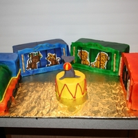 Circus Train Cake Birthday cake for a one year old. I used so many techniques in this cake. It was a lot of fun, but a lot of work.