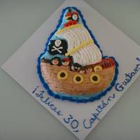Pirate Ship With Six On Board I'm not too happy with this cake: I have virtually no piping skills and I really don't like decorating cakes made with those...