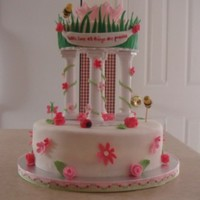 Garden Baby Shower Cake fondant covered round cake with fondant bugs and flowers