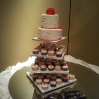 Cupcake And Wedding Cake Vanilla cake with persimmon colored gumpaste hydrangeas. cupcakes are devils food stuffed with oreo buttercream and vanilla stuffed with...