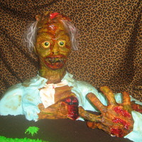 Sam The Zombie I made this cake for my kids halloween party at school...the kids cried and would not eat him