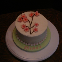 Cherry Blossom Birthday Cake This cake was made for a coworker of mine who is Korean. The cake is white cake with buttercream icing. The flowers are made from MMF. All...