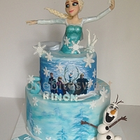 Frozen Theme Cake - Both characters are sculpted out of modeling chocolate . and hand-painted scene at the bottom.