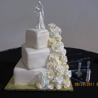 Ivory Falls   Wasc with Ivory fondant, gumpaste roses in white, off white and ivory. Cubic zirconia decorations and fibre optic light.