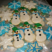 Winter Cookies I made 75 of these for my husbands office. I think I began decorating @ 12am beacuse I had just finished also making a logo cake.