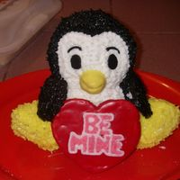 "Penguin Love For My Valentine The cake is a french vanilla pound cake with buttercream icing. The ""be mine"" heart and the wings are cookies. The beak is made..."