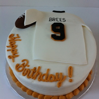 Drew Brees MMF jersey and football. Buttercream covered cake.