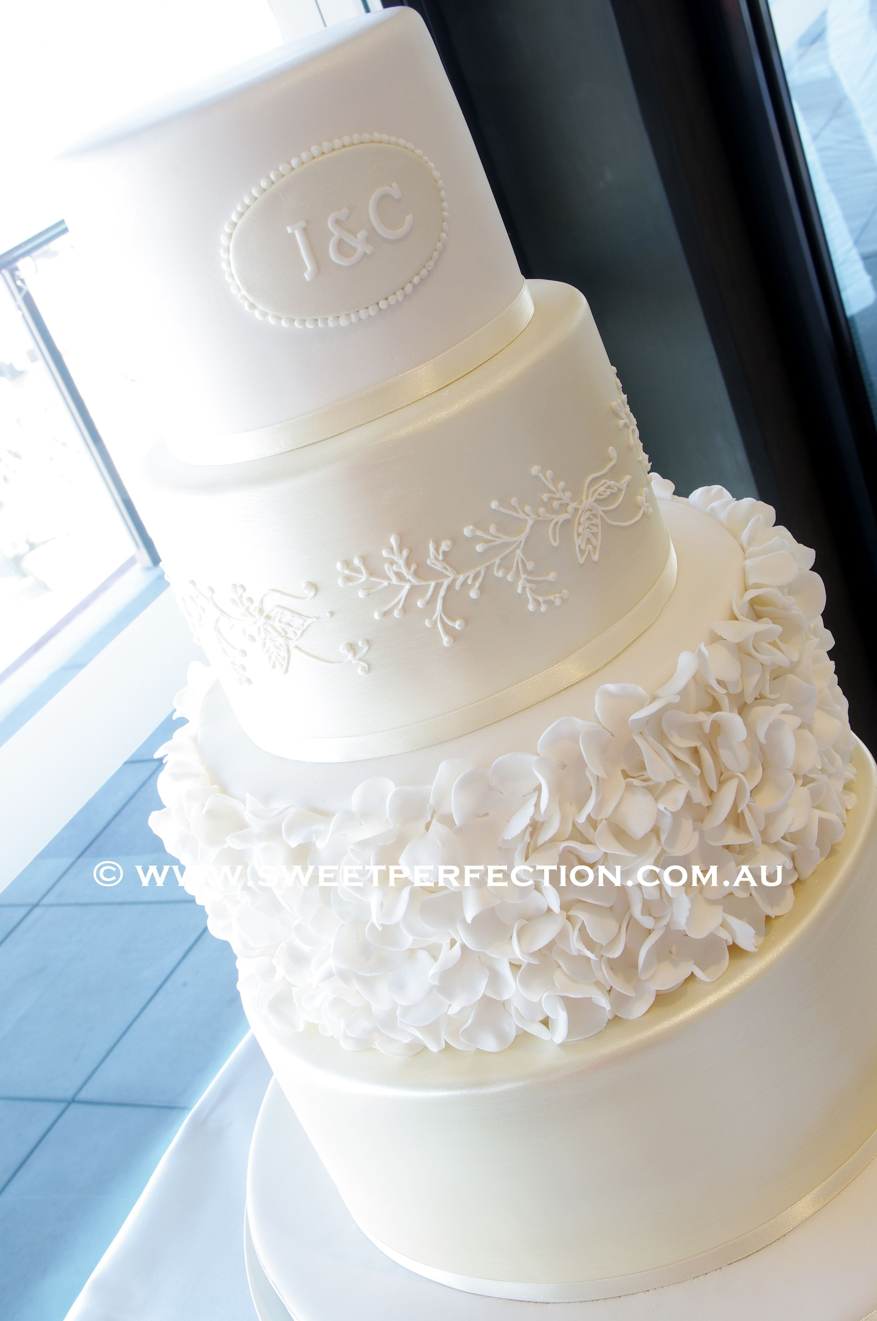 Pale Gold Fondant covered, brushed with pale gold, with ruffled petal design, and piped royal icing lacework based on bridal veil. Thanks for looking...