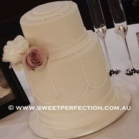 Romantic Art Deco Wedding Cake   Three tiers, cream fondant and art deco fondant and piping detail. Thanks for looking :-)