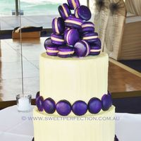 Purple Macaron Confection Wedding Cake   Salted Caramel Macarons on textured IMBC-covered two tiered mud cake. Thanks for looking!
