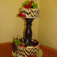 Chocolate And Fruit Top tier is Marble cake with chocolate buttercream filling and the bottom tier is Chocolate and White checkered cake with Chocolate...