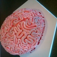 Brains Cake This was actually for a birthday cake. Red velvet cake carved into shape. Covered in Fondant and hand painted with watered down food...