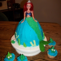 Little Mermaid barbie top the rest is cake with butter cream and candy for tail fin