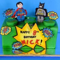 Lego Batman And Superman Cake MMF covered cake, gum paste decorations and edible images.