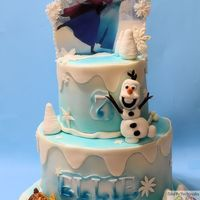 Frozen Theme Frozen Theme Birthday Cake Airbrushed marshmallow fondant covered cakes with handmade gum paste decorations. Elsa and Ana edible Image...