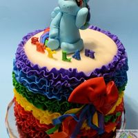 Rainbow Dash Mmf covered and decorated cake. Gum paste topper and letters.
