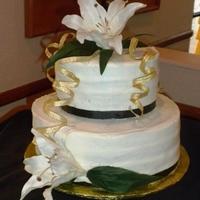 Lily Wedding Cake I used silk lilies and real ribbon to keep the cost low on this small round cake. Buttercream icing completes the look.