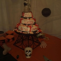 Halloween Themed Wedding Cake! My sister in-law wanted this cake for her wedding...She absolutely loved it! Top tier was white cake w/ strawberry filling. Bottom two...