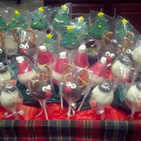 Christmas Cake Pop Display Cake pops include Santa Hats, Reindeer, Christmas trees, and Snowmen