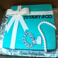 Tiffany Amp Company Birthday Cake With Charm Bracelet And Pearls Tiffany & Company birthday cake with charm bracelet and pearls