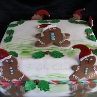 Gingerbread Man Christmas Cake Made for my friend... cherry ripe mud cake decorated with gingerbread men...in various stages of being eaten...lol