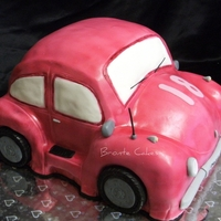 V-Dub Mud cakes, filled/ganached/carved/fondant/airbrushed. Gumpaste accessories.