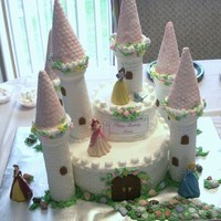 Princess Castle Castle for 3 y.o. grandaughter. Towers are ice cream cones with fondant. Buttercream cake. Thanks for all the ideas on C.C. TFL.