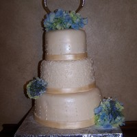 Wedding Cake With Blue Hydrangeas With A Touch Of Green