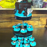 Beach Theme Cupcake Wedding Cake Top tier is chocolate cake, cupcakes are white and chocolate. Top tier covered in chocolate fondant, with teal wave pattern and bubbles....