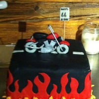 Motorcycle Birthday White cake with Vanilla IMBC, covered in fondant. Motorcycle made of fondant.