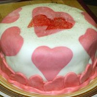 Valentine's Cake This is a spice cake c/ Chocolate buttercream and MMF. The darker hearts are sugar sprinkles applied with a paint brush and using cookie...