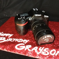 Nikon Camera   3D Nikon DSLR, all cake, icing and fondant. People thought it was real!