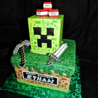Minecraft Cake   All buttercream, save for the TNT, sword and pickaxe. Made a small stencil to airbrush the blocky effect!