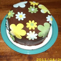 Donation Cake For Ms Fundraiser banana cake,milk choc icing,fondant flowers