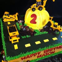 Construction Cake My friend found a similar cake online and gave the photo to me to recreate so I'm not sure who to give credit to. Done in buttercream...