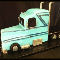Semi Truck Cake Covered in MMF. Not my cleanest work but I was in hurry to finish on a late night. :) this was for my nephew but hoping some of the...