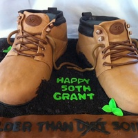 Work Boots Chocolate cake done in MMF. (Inside joke on the message in front of the cake :) I drew out a template from the side of a real boot and used...